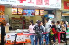 Shenzhen, China: Handmade Bread, people queue up to buy Stock Images