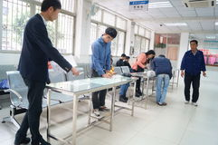 Shenzhen, China: health and epidemic prevention station. Shenzhen Baoan Xixiang health and epidemic prevention station, the workers in the examination Stock Image