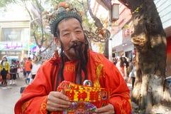 Shenzhen, China: het bedelen van mensen Fortuna te spelen Royalty-vrije Stock Afbeelding