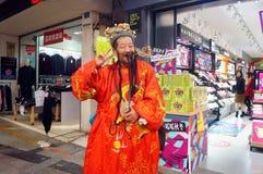 Shenzhen, China: het bedelen van mensen Fortuna te spelen Royalty-vrije Stock Foto's