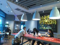Shenzhen, China: the indoor scenery of KFC restaurant, people enjoy delicious food. KFC restaurant indoor landscape, people are enjoying delicious food royalty free stock photography