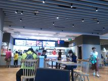 Shenzhen, China: the indoor scenery of KFC restaurant, people enjoy delicious food. KFC restaurant indoor landscape, people are enjoying delicious food royalty free stock images