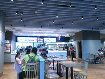 Shenzhen, China: the indoor scenery of KFC restaurant, people enjoy delicious food. KFC restaurant indoor landscape, people are enjoying delicious food stock images