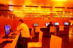 Shenzhen, China: the interior landscape of the library at night. At night, Baoan library interior landscape, readers are still reading, or access to the internet stock images