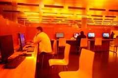 Shenzhen, China: the interior landscape of the library at night. At night, Baoan library interior landscape, readers are still reading, or access to the internet royalty free stock photo