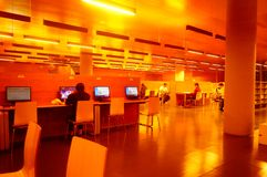Shenzhen, China: the interior landscape of the library at night. At night, Baoan library interior landscape, readers are still reading, or access to the internet stock photography