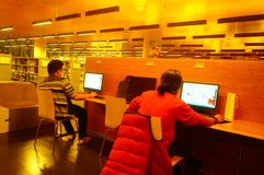 Shenzhen, China: the interior landscape of the library at night. At night, Baoan library interior landscape, readers are still reading, or access to the internet stock photos