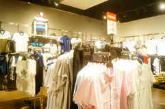 Shenzhen, China: interior view of clothing store Stock Photography