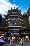 Shenzhen, China - July 16, 2018: Chinese pagoda in Dong Men Pedestrian street in the old Shenzhen city area crowded with people Royalty Free Stock Photo