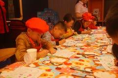 Shenzhen, China: KFC restaurant organized children`s painting activities, children happy to participate Stock Photography