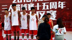 Shenzhen, China: KFC three player basketball match landscape stock video footage