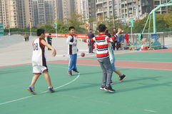 Shenzhen, China: Kids playing basketball Royalty Free Stock Images