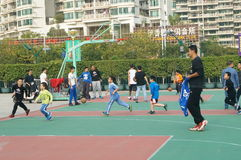 Shenzhen, China: Kids playing basketball Royalty Free Stock Image