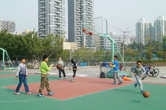 Shenzhen, China: Kids playing basketball Royalty Free Stock Photos