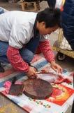 Shenzhen, China: killing the rabbit Stock Photography