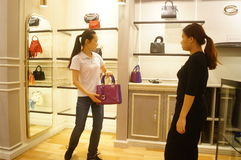 Shenzhen, China: leather bag shop Stock Photos