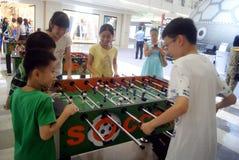 Shenzhen, China: Leisure Sports Soccer. Shenzhen Futian Huangting square, leisure sports soccer, children like to play Stock Photo