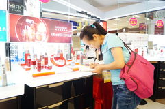 Shenzhen, China: mall cosmetics counters Stock Images