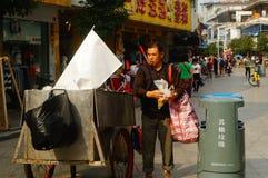 Shenzhen, China: a man picking up trash Royalty Free Stock Photo