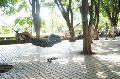 Shenzhen,china: A man sleeping under a tree Royalty Free Stock Photo