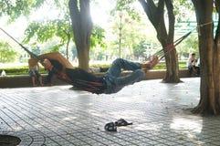 Shenzhen,china: A man sleeping under a tree Royalty Free Stock Photos