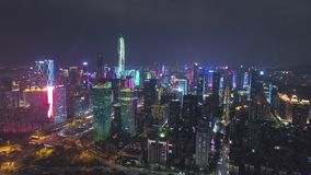 Shenzhen, China - March 30, 2019: Urban City and Light Show. Futian District. Aerial View. Reveal Shot. Drone Flies