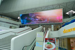 SHENZHEN, CHINA- MAY 11, 2017: Boarding area with a really big informative screen inside of the terminal ferry that Royalty Free Stock Images
