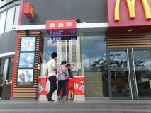 Shenzhen, China: McDonald`s restaurants, children and women are buying food. Royalty Free Stock Photos