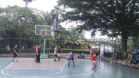 Shenzhen, China: men play basketball as a recreational sport. Royalty Free Stock Photo