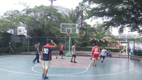 Shenzhen, China: men play basketball as a recreational sport. Royalty Free Stock Images