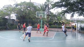 Shenzhen, China: men play basketball as a recreational sport. Stock Images