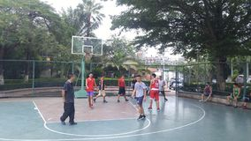 Shenzhen, China: men play basketball as a recreational sport. Stock Image