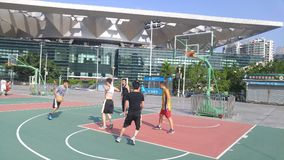 Shenzhen, China: men play basketball as a recreational sport. Royalty Free Stock Image