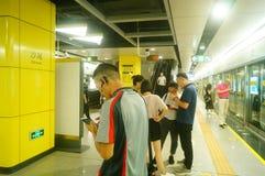 Shenzhen, China: Metro Line 7 and Sha Wei subway station landscape. Shenzhen Metro Line 7 and Sha Wei subway station landscape, men`s and children`s passengers stock photo
