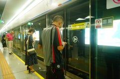 Shenzhen, China: Metro Line 7 and Sha Wei subway station landscape. Shenzhen Metro Line 7 and Sha Wei subway station landscape, men`s and children`s passengers royalty free stock image