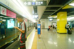 Shenzhen, China: Metro Line 7 and Sha Wei subway station landscape. Shenzhen Metro Line 7 and Sha Wei subway station landscape, men`s and children`s passengers royalty free stock images