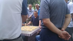 Shenzhen, China: middle-aged and elderly men play chess. In the morning, in Xixiang Park of Shenzhen, the middle-aged and old men played chess as entertainment stock image