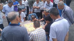 Shenzhen, China: middle-aged and elderly men play chess. In the morning, in Xixiang Park of Shenzhen, the middle-aged and old men played chess as entertainment stock photo