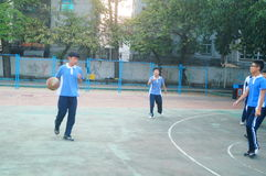 Shenzhen, China: middle school students playing basketball Royalty Free Stock Image