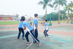 Shenzhen, China: middle school students playing basketball Royalty Free Stock Photo