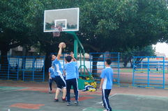 Shenzhen, China: middle school students playing basketball Royalty Free Stock Images