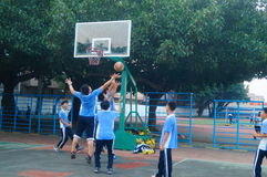 Shenzhen, China: middle school students playing basketball Stock Images