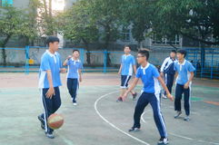 Shenzhen, China: middle school students playing basketball Stock Photo