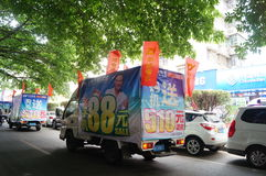 Shenzhen, China: mobile phone store promotions. Shenzhen Baoan Xixiang, mobile phone store promotions, car hanging billboards parade Stock Photography