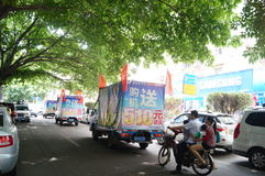 Shenzhen, China: mobile phone store promotions. Shenzhen Baoan Xixiang, mobile phone store promotions, car hanging billboards parade Stock Images