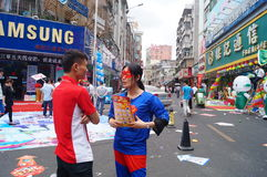 Shenzhen, China: mobile phone store promotions. Shenzhen Baoan Xixiang commercial street, May 1st Labor Day, mobile phone store promotions, lion dance, draw and Stock Images