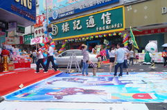 Shenzhen, China: mobile phone store promotions. Shenzhen Baoan Xixiang commercial street, May 1st Labor Day, mobile phone store promotions, lion dance, draw and Royalty Free Stock Image