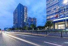 Shenzhen, china modern office building street view at twilight. Longhua district, shenzhen, china modern office building street view with light tail at twilight royalty free stock photography