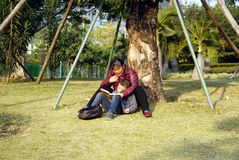 Shenzhen, china: mother and son to read a book Royalty Free Stock Photo