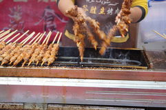 Shenzhen, China: mutton cubes roasted on a skewer Royalty Free Stock Photo